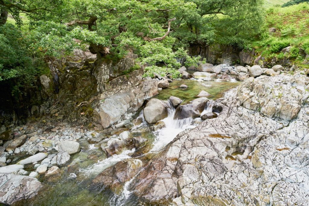 Fast flowing clear water of Galleny Force near Stonethwaite in the English Lake District-min