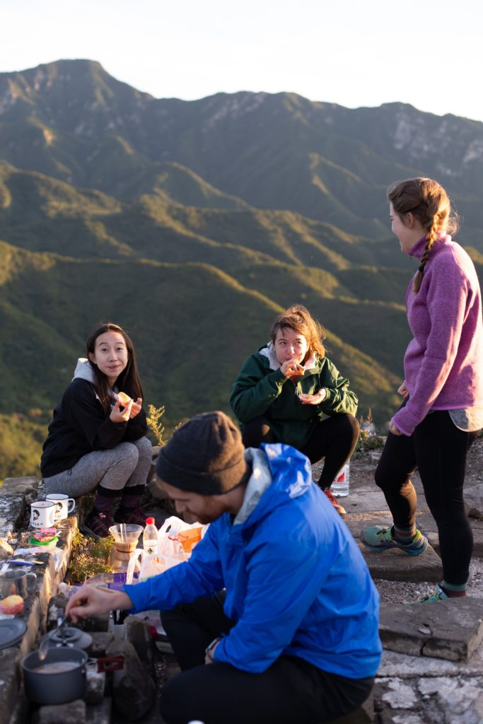Three women eating on a hike
