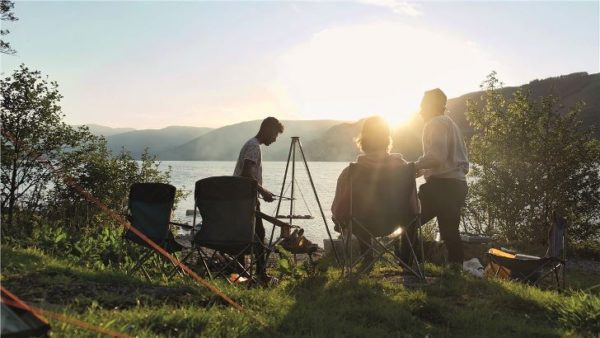Easy Camp Camp Fire Tripod Deluxe group cooking at sunset
